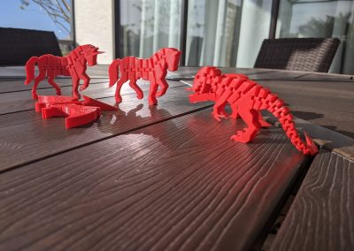 Bright red 3D printed dinosaurs